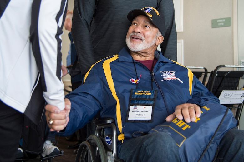 William Watson, a Korean War veteran, shakes hands with people after returning from Washington, D.C., with the Last Frontier Honor Flight, at Ted Stevens International Airport, Alaska, Oct. 20, 2018. The program offers veterans the opportunity to visit monuments erected in their honor such as the National World War II Memorial, the Korean War Veterans Memorial and the Vietnam Veterans Memorial.