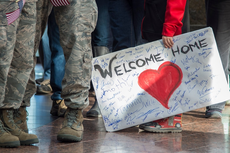 A child holds a 'welcome home' sign in celebration of the return of the Last Frontier Honor Flight, at Ted Stevens International Airport, Alaska, Oct. 20, 2018. The program offers veterans the opportunity to visit monuments erected in their honor such as the National World War II Memorial, the Korean War Veterans Memorial and the Vietnam Veterans Memorial.