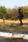 Pieces of metal debris uncovered by ROK engineers sit in the foreground during  a mine clearing operation at the Joint Security Area near Panmunjon, South  Korea, Oct. 16