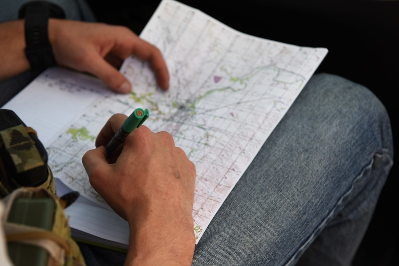 Senior Airman Steven, a 5th Air Support Operations Squadron joint terminal attack controller, puts coordinates on a map in Belle Fourche, S.D. on Oct. 17, 2018. JTACs from Joint Base Lewis-McChord, Wash., participated in Combat Raider 19-1, an exercise hosted by the 28th Bomb Wing, to train with bombers from all 8th Air Force bases. (U.S. Air Force photo by Airman 1st Class Thomas Karol)