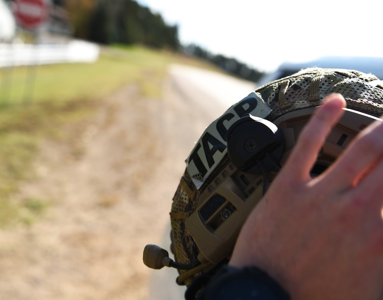 Senior Airman Steven, a 5th Air Support Operations Squadron joint terminal attack controller, puts a helmet on in Belle Fourche, S.D., Oct. 17, 2018. JTACs from Joint Base Lewis-McChord, Wash., participated in Combat Raider 19-1, an exercise hosted by the 28th Bomb Wing, to train with bombers from all 8th Air Force bases. (U.S. Air Force photo by Airman 1st Class Thomas Karol)
