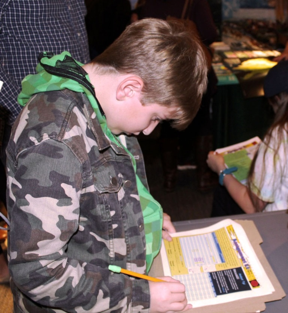 """A middle-schooler uses his math skills to break a code and stop a """"terrorist attack"""" at a STEM festival at NSA's National Cryptologic Museum."""
