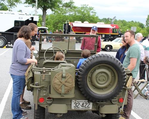 Kids got to climb into World War II vehicles like this jeep.