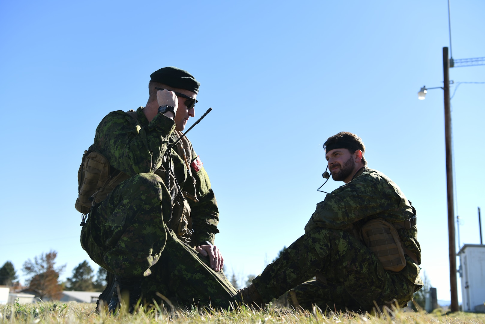 Capt. Chris Tymchuk, a joint tactical air controller troop commander assigned to the Royal Canadian Horse Artillery, 1st Regiment, relays coordinates to a B-1 while on the ground in Belle Fourche, S.D., Oct. 17, 2018. JTACs from the 1st RCHA assisted in Combat Raider 19-1, an exercise that helped them become familiar with the B-1 and its capabilities. (U.S. Air Force photo by Airman 1st Class Thomas Karol)