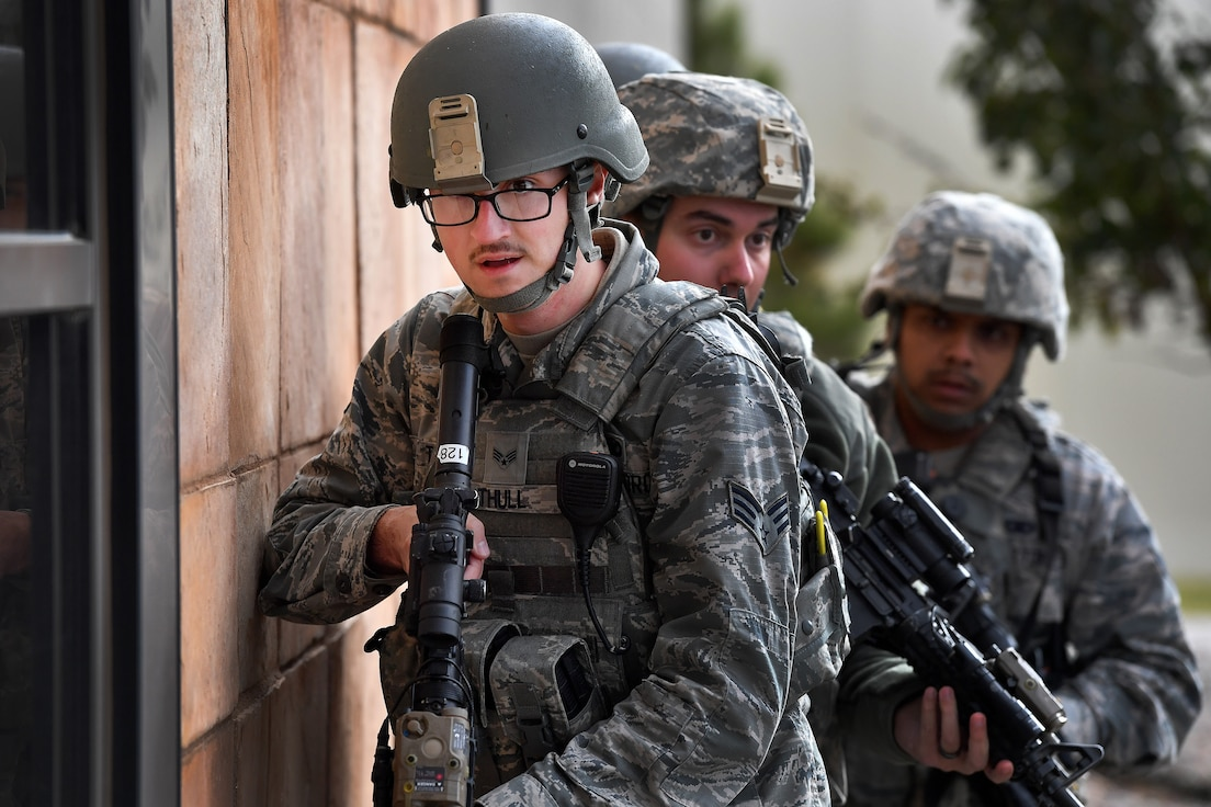 50th Security Forces Squadron patrolmen prepare to enter and clear the fitness center during Opinicus Vista 18-2 at Schriever Air Force Base, Colorado, Oct. 17, 2018. The exercise was held to test and evaluate the readiness and emergency response capabilities of the installation. (U.S. Air Force Photo by Dennis Rogers)