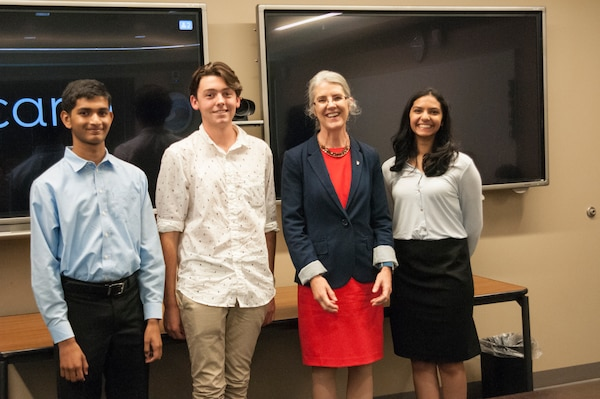 (l to r.) Karthik Yegnesh, runner-up; Charles Noyes, first place winner; Dr. Deborah Frincke, NSA Research Director; Rucha Joshi, runner-up