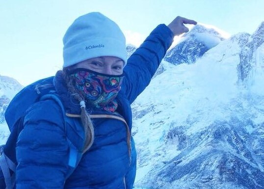 U.S. Air Force Master Sgt. Amber Houston, 39th Wing Staff Agency superintendent, points to the summit of Mount Everest, April 13, 2018.