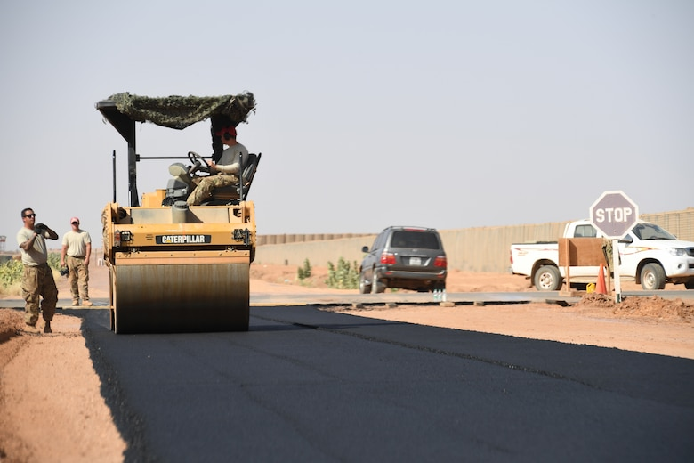 A U.S. Air Force 31st Expeditionary Rapid Engineer Deployable Heavy Operation Repair Squadron Engineer heavy equipment operator, compacts freshly laid asphalt to prove the quality of the surface on Nigerien Air Base 201, Agadez, Niger, Oct. 19, 2018. Before the runway can be finished, REDHORSE engineers must test the asphalt to ensure it can withstand the desert environment and airfield operations. (U.S. Air Force by Tech. Sgt. Rachelle Coleman)