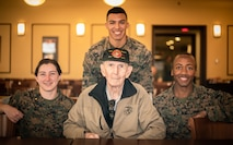 U.S Marine veteran, Louis Buttell, poses for a photo with Marines, Marine Corps Base Quantico, Oct. 18, 2018. The service members got together for the reunion of The Basic School's first special basic class of 1950, some of whom served together in Korea.