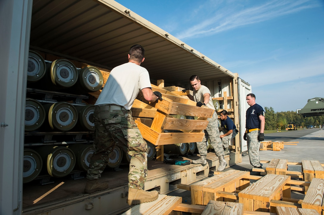 U.S. Airmen assigned to the 86th Munitions Squadron unpack a fresh shipment of munitions on Ramstein Air Base, Germany, Oct. 19, 2018. The 86th MUNS recently received the largest shipment of munitions on Ramstein since 1999. (U.S. Air Force photo by Senior Airman Joshua Magbanua)