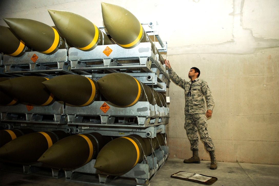 U.S. Air Force Staff Sgt. Jeric Hernandez, 86th Munitions Squadron quality assurance inspector, inspects a fresh shipment of large ordnance on Ramstein Air Base, Germany, Oct. 19, 2018. Ramstein recently received one of its largest munitions shipments in recent history. (U.S. Air Force photo by Senior Airman Joshua Magbanua)