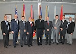 Leaders from private industry pose with DLA leaders, including Director Lt. Gen. Darrell Williams.