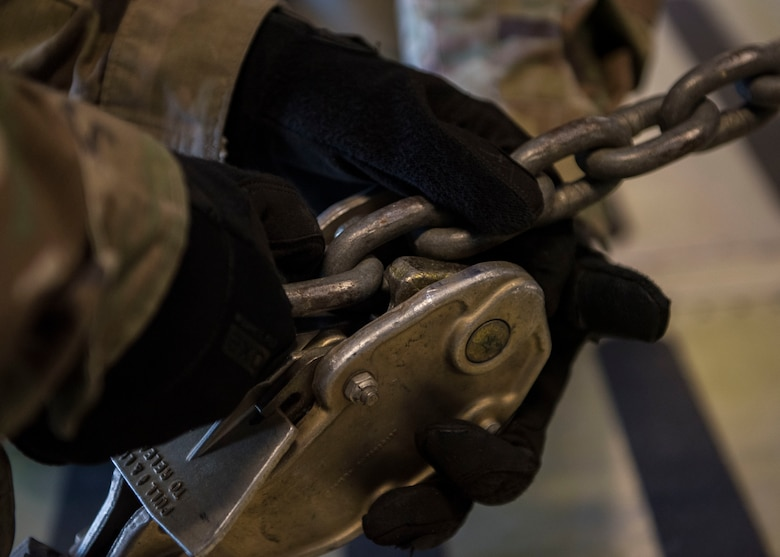 A U.S. Army Soldier locks a chain during a training exercise at Joint Base Langley-Eustis, Virginia, Oct. 18, 2018.