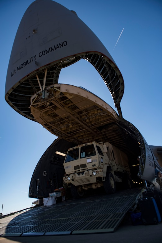 A U.S. Army Soldier drives a cargo truck off a U.S. Air Force C-5M Super Galaxy during a training exercise at Joint Base Langley-Eustis, Virginia, Oct. 19, 2018.