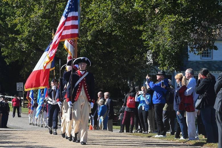 The 3rd Infantry Old Guard marches the flags to the Monument to Alliance and Victory during the Yorktown Day parade at Colonial National Historic Park, Virginia, Oct. 19, 2018.