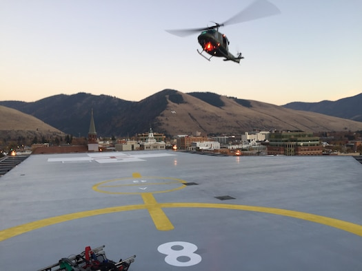 A UH-1N helicopter lands for patient drop off at St. Patrick Hospital and Health Sciences Center Oct. 22, 2018, at Missoula, Mont.