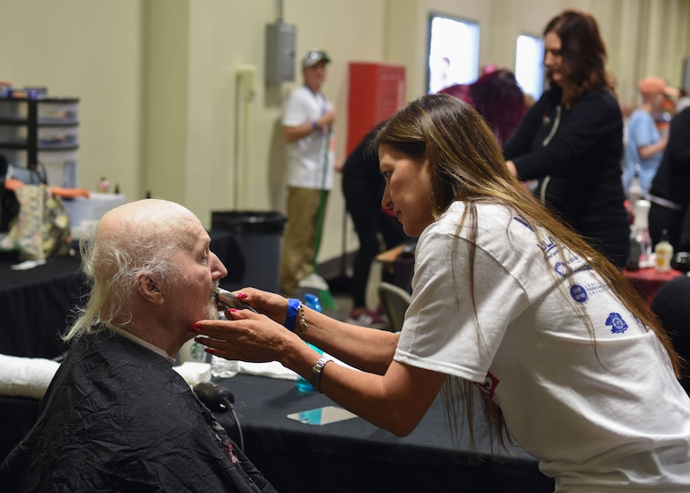 A local veteran receives a haircut and trim by a Veteran Stand Down volunteer Oct. 20, 2018 at the Santa Maria Fair Grounds, Calif. Over 180 services were offered for the veterans in need in the local community.