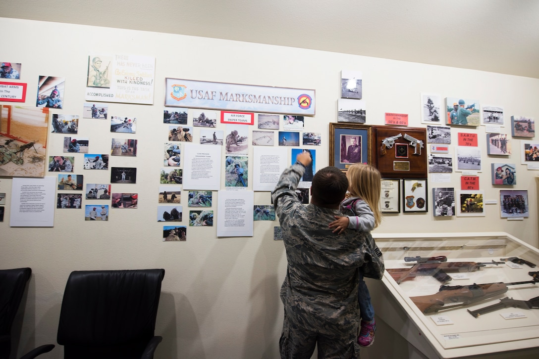 U.S. Air Force Master Sgt. Justin Bosh, 72nd Security Forces Squadron, Tinker Air Force Base, Okla., explains part of an exhibit to his daughter at the Security Forces Museum Foundation at Joint Base San Antonio-Lackland, Texas.