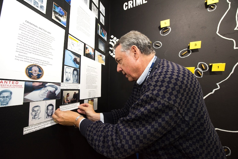 Rudy Purificato, Airman Heritage Museum director, works on a new crime scene exhibit in the Security Forces Museum at Joint Base San Antonio-Lackland, Texas.