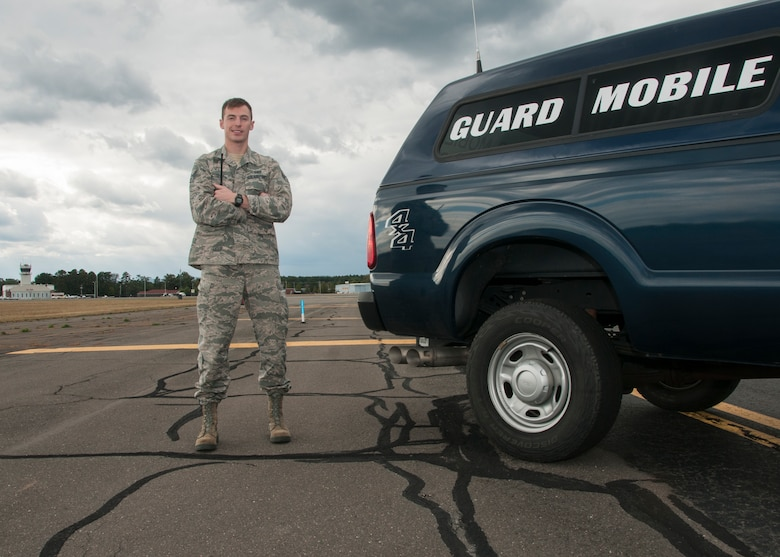 Senior Airman Calvin Cooper, 104th Operations Group airfield management shift leader, poses for a photo on the flight line Oct. 17, 2018, at Barnes Air National Guard Base, Massachusetts. Cooper was recently selected to become a pilot at the 104th Fighter Wing. (U.S. Air National Guard Photo by Airman 1st Class Randy Burlingame)