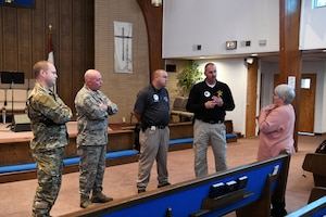 photo of Airmen and teacher