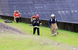 Team members from Wells Bridge, Otego and Unadilla fire departments prepare for a rescue simulation training exercise in support of the U.S. Army Corps of Engineers, Baltimore District, at East Sidney Lake Dam in Delaware County, New York, Oct. 13, 2018.  (U.S. Army photo by Brianna K. Dandridge)