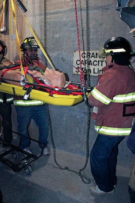 First responders from local fire departments, alongside U.S. Army Corps of Engineers, Baltimore District team members, practice an emergency basket lift and chain fall in preparation for assisting injured personnel during a training exercise at East Sidney Lake Dam in Delaware County, New York, Oct. 13, 2018. More than 25 members of the Wells Bridge, Otego and Unadilla fire departments practiced safety procedures and rescue operations in confined spaces during the training simulation. (U.S. Army photo by Brianna K. Dandridge)