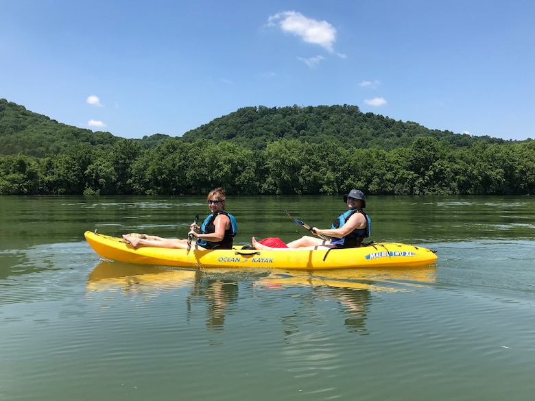 Sarah Wiles (Right), geologist with the U.S. Army Corps of Engineers Nashville District, and Karen Halter, accountant in the Resource Management Division, kayak on the Cumberland River in Gainesboro, Tenn., June 16, 2018 on Leg 24 of a 650.4-mile journey of the Cumberland River. The objective of navigating the waterway was to celebrate the 130th Anniversary of the U.S. Army Corps of Engineers Nashville District, reflect on the development of the Cumberland River Basin, remember the past, enjoy the present, and dream about the future of the waterway that is vitally important to the region. (USACE Photo)