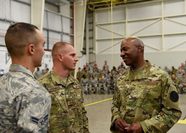 Chief Master Sgt. Matthew Lammers, 56th Aircraft Maintenance Squadron superintendent and Chief Master Sgt. of the Air Force Kaleth O. Wright speak during a tour of the 56th Maintenance Group Oct. 22, 2018 at Luke Air Force Base, Ariz.
