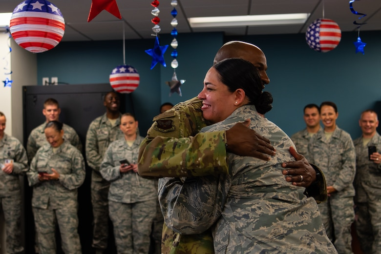 Chief Master Sgt. of the Air Force Kaleth O. Wright hugs an Airman during a meet and greet in the 56th Medical Group, Oct. 22, 2018 at Luke Air Force Base, Ariz.
