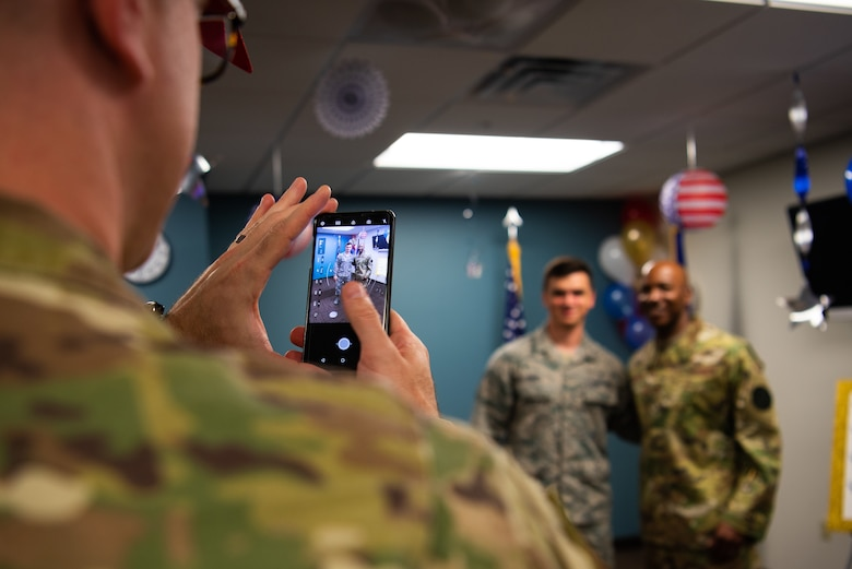 Chief Master Sgt. of the Air Force Kaleth O. Wright poses with an Airman for a photo during a meet and greet in the 56th Medical Group, Oct. 22, 2018 at Luke Air Force Base, Ariz.