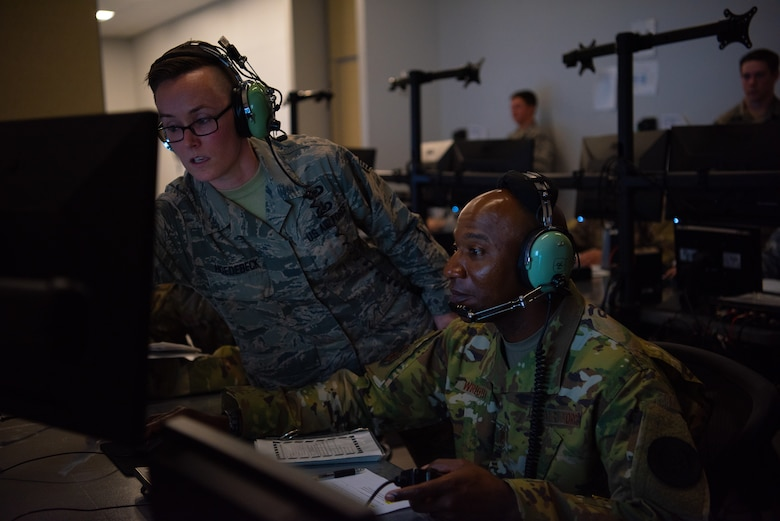 Staff Sgt. Amber Hoedebeck, 607th Air Control Squadron weapons director, guides Chief Master Sgt. of the Air Force Kaleth O. Wright as he conducts an in a flight simulation at the 607th ACS, Oct. 22, 2018 at Luke Air Force Base, Ariz.