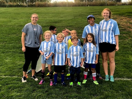 Sara Burton (far right), a junior cadet at the U.S. Air Force Academy, stands with the children and staff on the  Avengers soccer team, sponsored by the Colorado Springs youth sports program. Burton was the team's head coach until the season ended in October. (Courtesy photo)