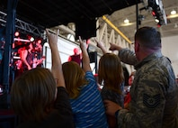 An Airman and his children enjoy the front row of a Disturbed concert at Creech Air Force Base, Nevada, Oct. 23, 2018. Disturbed partnered with the USO to perform a concert for Creech Airmen after learning about the wing mission. (U.S. Air Force photo by Senior Airman Christian Clausen)