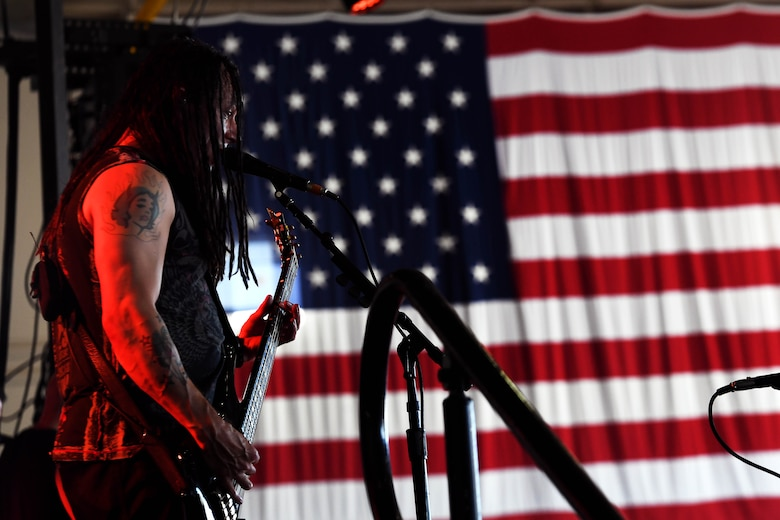 John Moyer, Disturbed bassist, performs for Creech Air Force Base Airmen Oct. 23, 2018. Disturbed partnered with the USO to perform a concert for Creech Airmen after learning about the wing mission. (U.S. Air Force photo by James Thompson)