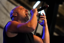 David Draiman, Disturbed lead vocalist, performs for Creech Air Force Base Airmen Oct. 23, 2018. Disturbed partnered with the USO to perform a concert for Creech Airmen after learning about the wing mission. (U.S. Air Force photo by James Thompson)