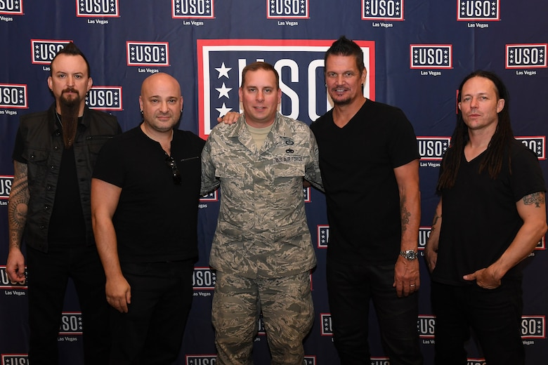 Tech. Sgt. Jason, 30th Reconnaissance Squadron flight chief, takes a photo with Disturbed at Creech Air Force Base, Nevada October. 23, 2018. Disturbed came to Creech via the USO and performed a concert for Airmen after learning about the wing mission. (U.S. Air Force photo by Senior Airman Christian Clausen)