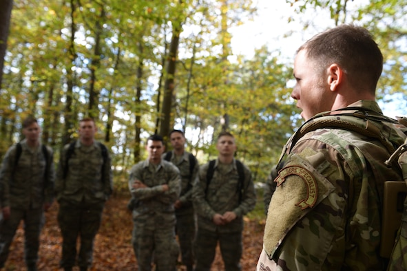 Tech. Sgt. Dereck Day, a 48th Operations Support Squadron Survival, Evasion, Resistance and Escape specialist, briefs a group of Airmen during SERE training at Royal Air Force Lakenheath, England, Oct. 18, 2018. The SERE instructors conducted RAF Lakenheath's first training program open to non-aircrew personnel. (U.S. Air Force photo by Airman 1st Class Shanice Williams-Jones)