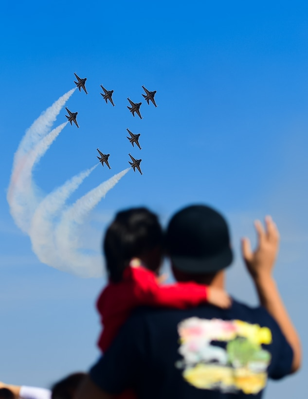 Spectators watch the Republic of Korea's 53rd Demonstration Group, also known as the Black Eagles, perform at the Gyeongnam Sacheon Aerospace Expo at Sacheon Air Base, South Korea, Oct. 25, 2018.