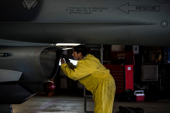 U.S. Air Force Staff Sgt. Martin Perez, 52nd Aircraft Maintenance Squadron tactical aircraft maintainer, inspects an F-16 Fighting Falcon intake at Spangdahlem Air Base, Germany, Sept. 13, 2018. Inspections are conducted after each flight to ensure there are no foreign objects, damage, or fuel leaks in the intake. (U.S. Air Force photo by Airman 1st Class Valerie Seelye)