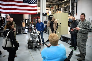 Master Sgt. David Pinkham answers questions about the training requirements of explosive ordnance disposal (EOD) specialists and various tools they use, like the remote-controlled robot at center.  The visit took place during the annual Boss Day tour at the 932nd Airlift Wing, October 13, 2018 at Scott Air Force Base, Ill. Pinkham is an explosive ordnance disposal (EOD) specialist assigned to the 932nd Civil Engineer Squadron. Boss Day helps civilian employers better understand the Air Force Reserve mission and strengthens the employer-reservist relationship. The 932nd AW is made up of four core groups including the 932nd Maintenance Group, Medical Group, Mission Support Group, and Operations Group.  The Illinois unit is the only Air Force Reserve Command wing, attached to 22nd Air Force, that flies the C-40C.  (U.S. Air Force photo by Lt. Col. Stan Paregien)