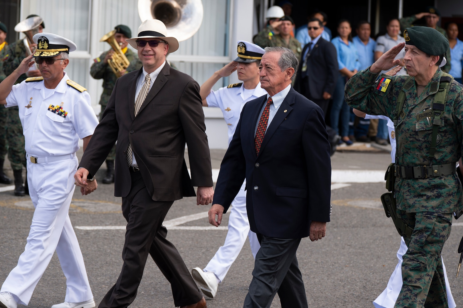 U.S. Ambassador to Ecuador, Todd C. Chapman (center-left) and Ecuadorian Minister of Defense Oswaldo Jarrin (center-right) are escorted during an opening ceremony at one of two medical sites.
