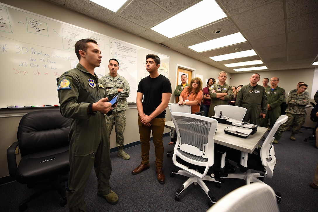 Capt. Phillip Huebner, 37th Flying Training Squadron instructor pilot, speaks during the Spark Cell grand opening Oct. 19, 2018, on Columbus Air Force Base, Mississippi. The innovation team is requiring all individuals interested in 3D printing to get signed off by a Spark Cell member first to help protect the equipment. (U.S. Air Force photo by Airman 1st Class Keith Holcomb)
