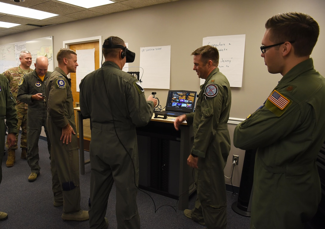 Maj. Ryan Brewer, 14th Flying Training Wing director of innovation, helps Col. Derek Stuart, 14th Operations Group commander, use a virtual reality headset Oct. 19, 2018, on Columbus Air Force Base, Mississippi. Virtual reality headsets, 3D printers, tablets and laptops fill the Spark Cell for Team BLAZE to use while they create and explore their ideas. (U.S. Air Force photo by Airman 1st Class Keith Holcomb)