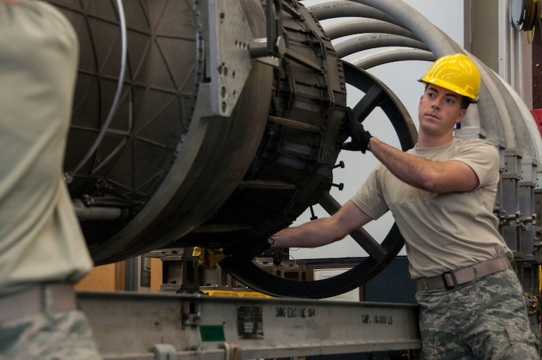 Senior Airman Andrew Feighery, 104th Maintenance Squadron aircraft engine mechanic, removes an augmenter module Oct. 17, 2018, at Barnes Air National Guard Base, Massachusetts. Feighery's recent deployment experience and mechanical engineering studies at The University of Massachusetts have further developed his skills as a mechanic. (U.S. Air National Guard Photo by Airman 1st Class Randy Burlingame)