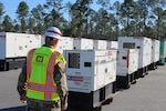 USACE has received 7 FEMA Mission Assignments (7 active, 6 closed), totaling more than $10.5 million for disaster response to Hurricane Michael-damaged areas. One of those missions is to provide Temporary Emergency Power. The USACE Temporary Power PRT and the 249th Engineer Battalion are deployed and assessing sites for installation of emergency generators. Sergeant First Class Robert Fox, 249th Engineer Battalion, C Company out of Fort Belvoir, Virginia, inspects a generator upon delivery to the Incident Support Base in Albany, Ga.  (U.S. Army photo by Chris Gardner)