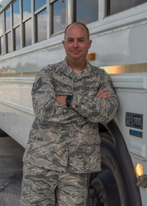 "TSgt. Justin Hartley, 502d Logistics Readiness Squadron Vehicle Operations Support Supervisor, poses in front of one of the shuttles Joint Base San Antonio provides to it's passengers on the installation Sept. 9, 2018. Hartley aided in the efforts developing the JBSA ""Find My Ride"" app to enhance JBSA's shuttle passenger's experience. (U.S. Air Force photo by: Airman Shelby Pruitt)"