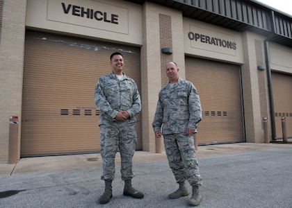 "TSgt. Justin Hartley, 502d Logistics Readiness Squadron Vehicle Operations Support Supervisor, and TSgt. Cody Dalton, 502d LRS Contracting Office Representative, pose in front of the Joint Base San Antonio-Lackland Vehicle Operations Squadron Sept. 9, 2018.  Dalton and Hartley are key players in developing JBSA's ""Find My Ride"" app. (U.S. Air Force photo by: Airman Shelby Pruitt)"