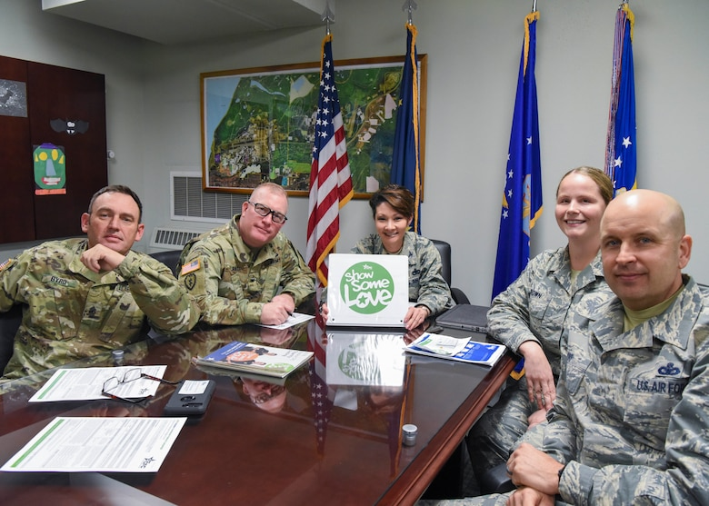 "Leadership from the 673d Air Base Wing meets with U.S. Air Force Tech. Sgt. Jessica Brown, a 673d ABW dedicated Combined Federal Campaign key worker, to discuss ways of donating to the 2018 CFC, ""Show Some Love,"" at Joint Base Elmendorf-Richardson, Alaska, Oct. 23, 2018. From the left, U.S. Army Sgt. Maj. Jerry Byrd, 673d ABW garrison sergeant major; U.S. Army Col. Adam Lange, JBER deputy commander; U.S. Air Force Col. Patricia Csànk, 673d ABW and JBER commander; Brown; and U.S. Air Force Chief Master Sgt. Charles Orf, 673d ABW command chief."