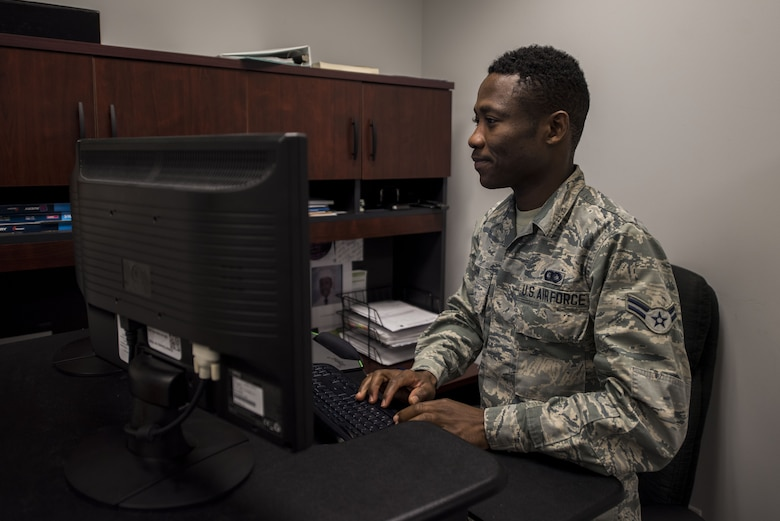 Airman 1st Class Sewa Gunn, 375th Operations Support Squadron commander support staff, tracks individual squadron member's records at Scott Air Force Base, Illinois on October 16, 2018. Gunn joined the Air Force one year after leaving his home country of Togo, Africa. Gunn recieved a visa through the Diversity Immigrant Visa program, which gives out 50,000 immigrant visas anually.(U.S. Air Force photo by Senior Airman Daniel Garcia)